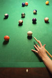 Female hand preparing to hit pool ball. stock image