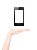 Female hand presents blank smart phone Stock Photography