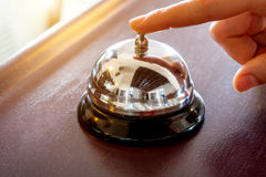 Female hand presses the button Royalty Free Stock Image