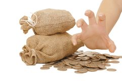 Female hand protects bags with money. Isolated on white Stock Photography