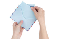 Female hand pulls a letter out of the envelope airmail Stock Images