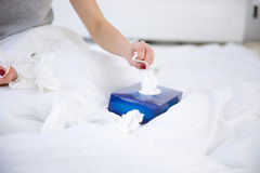 Female hand pulls out a napkin from the box Royalty Free Stock Image