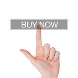 Female hand pushing on a buy now sign Royalty Free Stock Images