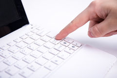 Female hand pushing enter button on laptop keyboard Stock Photography