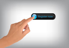 Register now. Female hand pushing a register now button royalty free stock images