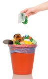 Female hand putting  plastic cup into  bucket of household waste isolated. Female hand putting a plastic cup into a bucket of household waste isolated on white Royalty Free Stock Image