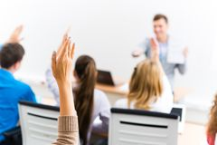 Female hand raised in class Royalty Free Stock Photos