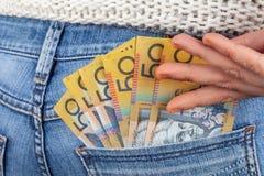 Female hand reaching for 50 Australian dollar bills. royalty free stock photo