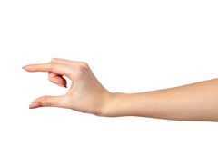 Female hand reaching for something on white. Well shaped Female hand reaching for something isolated on a white background royalty free stock photography