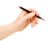 Female hand is ready for drawing with black pen Royalty Free Stock Image