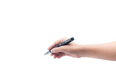 Female hand is ready for drawing with black pen. Royalty Free Stock Photography