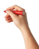 Female hand is ready for drawing with red marker. Isolated Royalty Free Stock Image