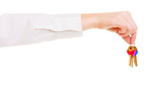 Female hand real estate agent holding set of keys to new house Royalty Free Stock Photos