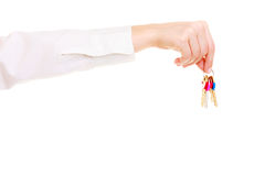 Female hand real estate agent holding set of keys to new house Royalty Free Stock Photography