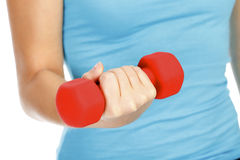 Female hand with a red barbell Stock Photography