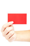 Female hand with red card on white background. Stock Photos