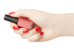 Female hand with red nail polish bottle Stock Photo