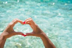 Female hand with red nail in shape of heart. Love concept. Female hand with red nail in shape of heart. Love summer concept royalty free stock image
