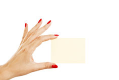 Female hand with red nails holding a blank card Stock Photography