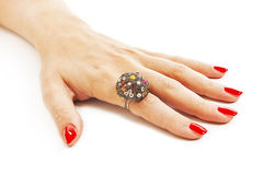 Female hand with red nails with ring Stock Photos
