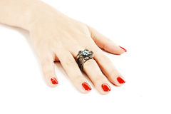 Female hand with red nails with ring royalty free stock images