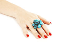 Female hand with red nails with turquoise ring Stock Photos