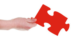 Female hand with red puzzle piece Stock Photo