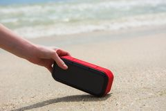 Woman take bluetooth portable speaker. Female hand and red wireless usb acoustic outdoors Stock Photos