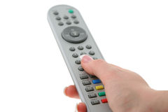 Female hand with remote control Stock Photos