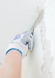 Female hand repairs wall Stock Photo