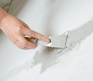 Female hand repairs wall Royalty Free Stock Photos