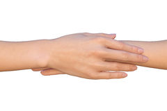 Female hand rests on top of another hand Royalty Free Stock Photography