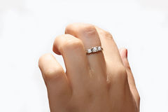Female hand with a ring of white gold royalty free stock image