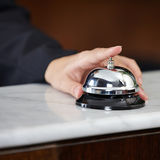 Female hand ringing hotel bell Royalty Free Stock Photography