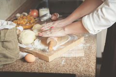 Female hand rolled sheet of dough with rolling pin Royalty Free Stock Images