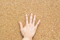 Female hand on the sand at the beach Royalty Free Stock Photography