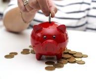 Female hand saving money Stock Photography