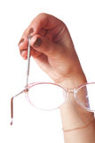Female hand with screw-driver and glasses Stock Photography