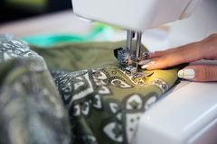 Female hand with sewing machine Royalty Free Stock Photos