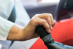 Female hand   on a shift knob Royalty Free Stock Photography