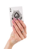 Female hand showing ace of spades card Stock Photo