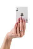 Female hand showing clover ace card Stock Photo