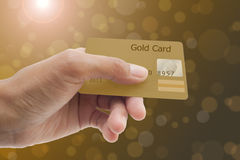 Use a credit card. Female hand showing credit card Stock Photo