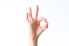 Female hand showing the gesture from contacting each other index finger and thumb is isolated on a white background Royalty Free Stock Photography