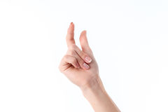 Female hand showing the gesture with raised up the index finger and thumb Royalty Free Stock Photo
