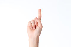 Female hand showing the gesture with raised up one finger isolated on white background Royalty Free Stock Photos