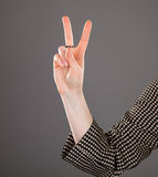 Female hand showing positive gesture. On grey background Royalty Free Stock Photos