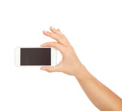 Female hand showing smartphone of white screen, front view, isolated. Stock Photo