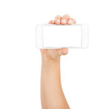 Female hand showing smartphone of white screen, front view, isolated. Royalty Free Stock Image