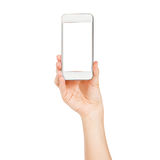 Female hand showing smartphone of white screen, front view, isolated. Royalty Free Stock Photo